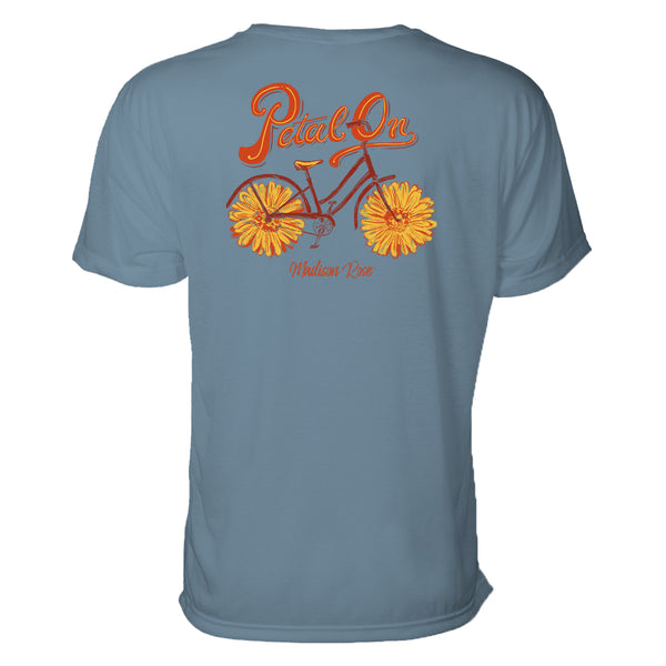 "This cute women's t-shirt features a graphic design of a bicycle where the tires are actually flowers petals. Above the design are the words ""Petal On."" the colors are yellows and oranges."