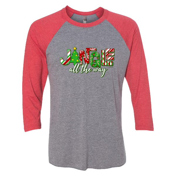 "This cute holiday t-shirt says ""Jingle all the way."" The lettering is bold and fun with holiday colors and seasonal patterns."