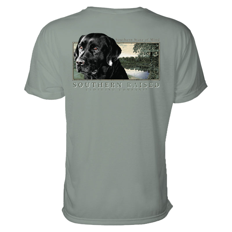 Southern State Mind t-shirt. Black Labrador Retriever and water scene graphic illustration on Comfort Colors t-shirt. Color is bay. Southern Raised Clothing Company