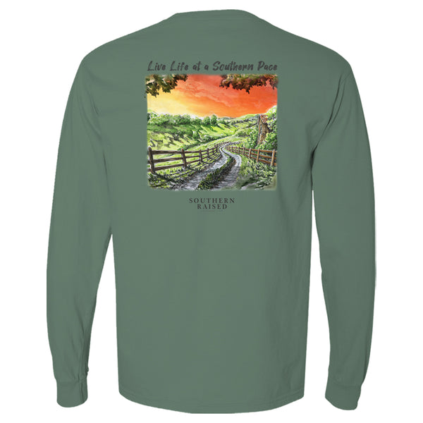 "Southern t shirt slogan is ""Live Life at a Southern Pace"" and scene is winding country road in a field at sunset. Comfort Color tee is light green."