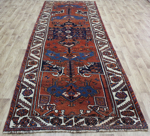 AN OUTSTANDING PERSIAN SHIRAZ LONG RUNNER 380 X 130 CM
