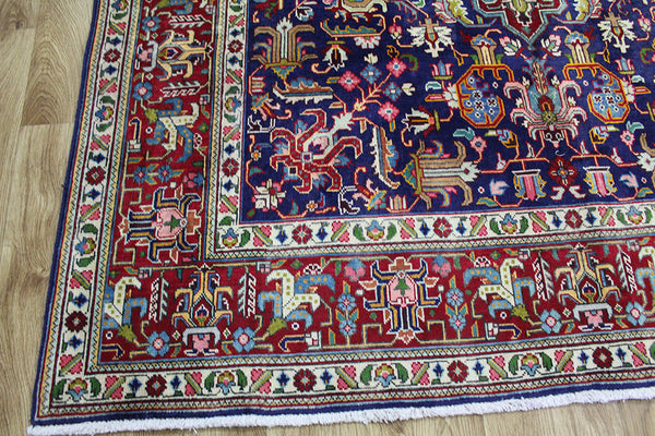 A good example of a Persian Tabriz carpet blue wool carpet 303 x 195 cm
