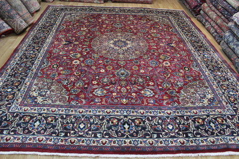VINTAGE PERSIAN MASHAD CARPET OF TRADITIONAL DESIGN, 345 X 295 CM