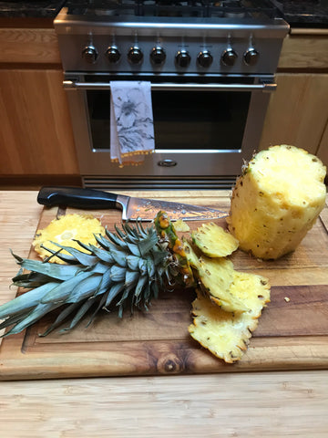 shun knife slicing pineapple