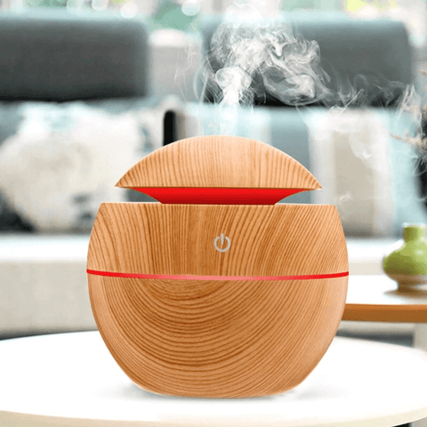 Essential oil diffuser with mist in the living room