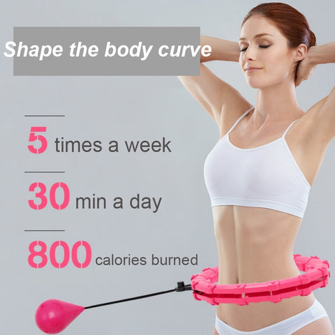 Woman showing progress with pink weighted hoola hoop
