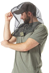 Man showing how to easily put on Bug Baffler insect protective headset.