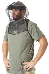 Side view of man wearing insect protective headset