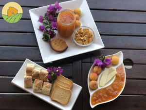 Apricot jam served with toast, baguette, cupcake, cereals, butter and fresh apricots fruit.