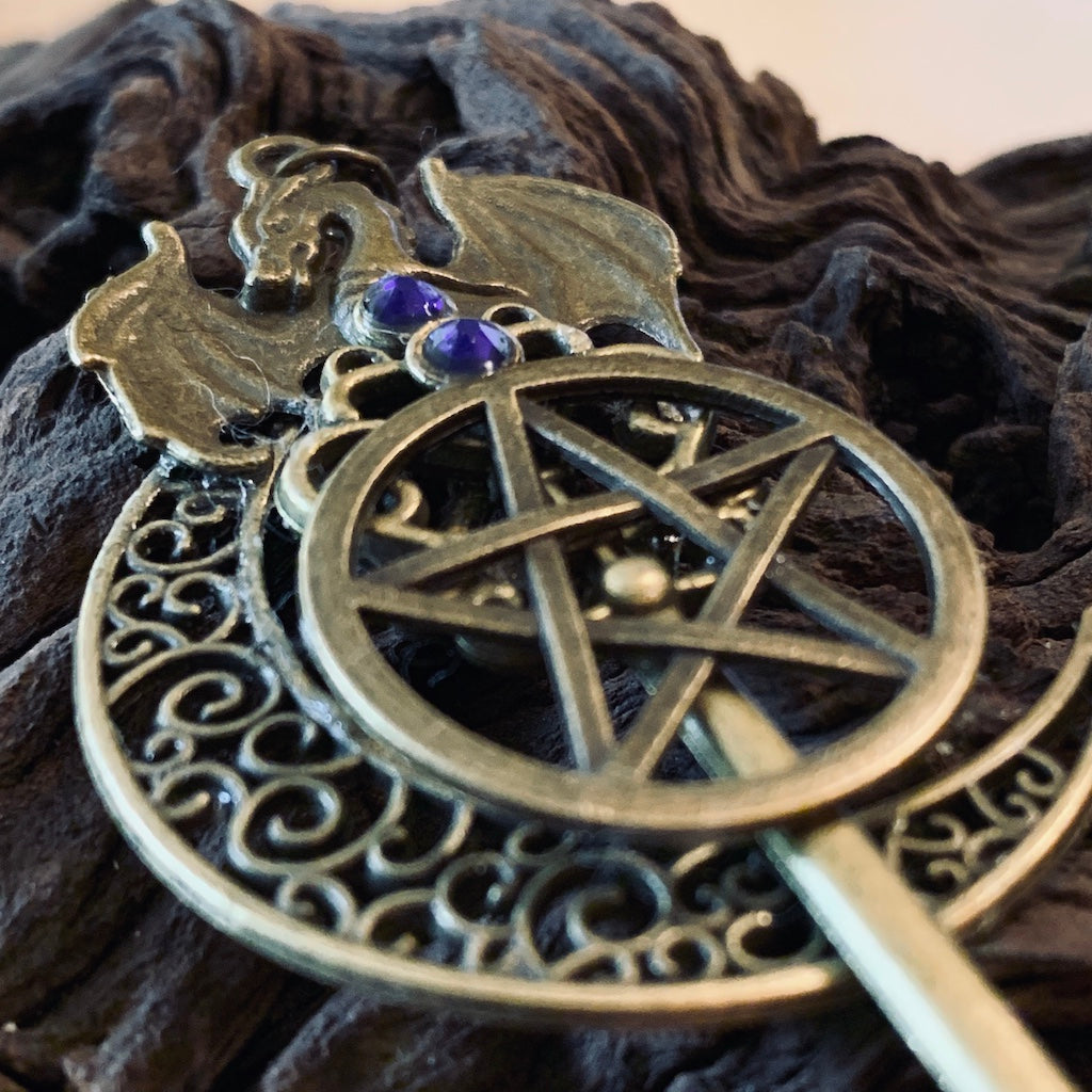 An image of the antique bronze pentagram dragon moon skeleton key necklace from Uncorked & Bottled Up