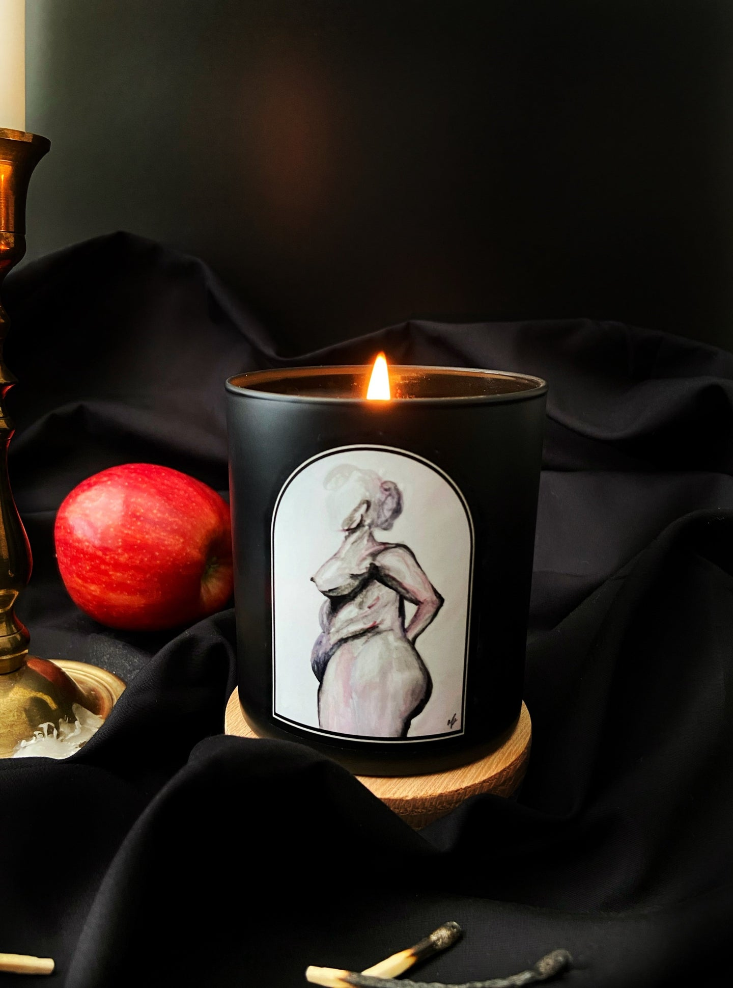 Apple Candle Soy candle in a black jar with apple notes figure study nude female figure water color painting art arch candle label nudesse candle nude female figure