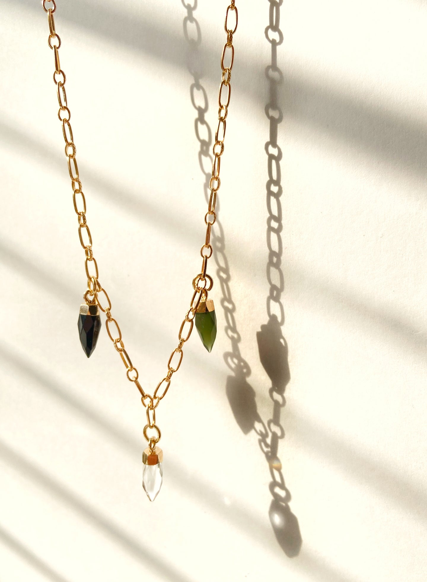three faceted crystal dagger charms on a gold plated chain necklace black crystal, clear quartz crystal, green crystal Faceted Dagger Necklace Shadow