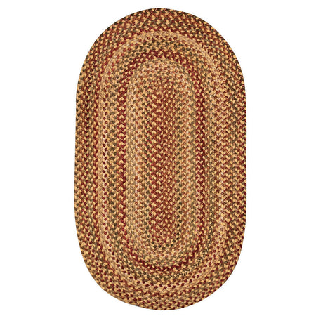 oval braided gold, red, and green rug