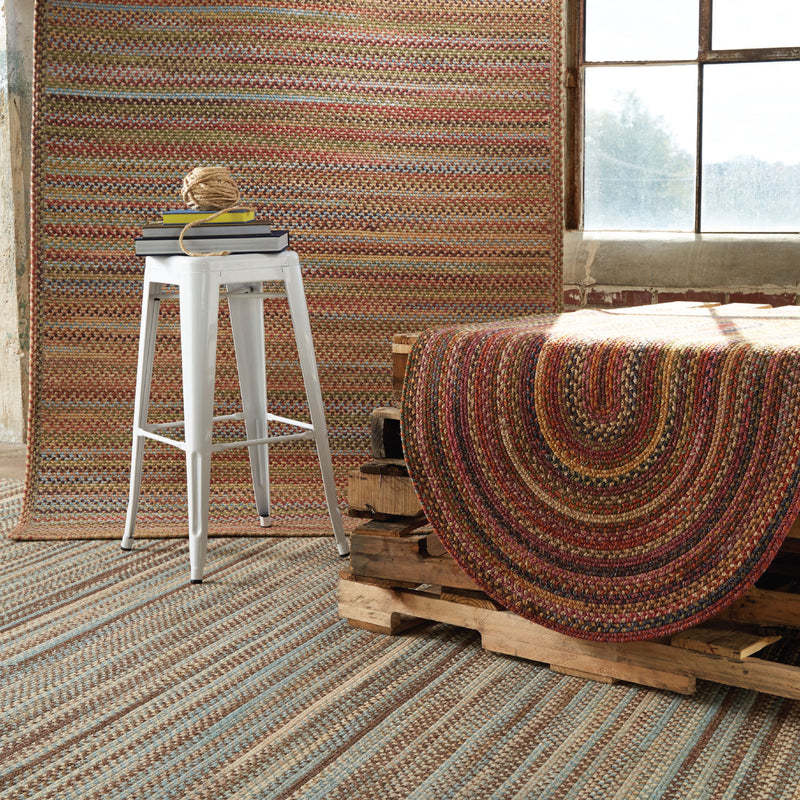 various american legacy braided rugs covering the wall and floor