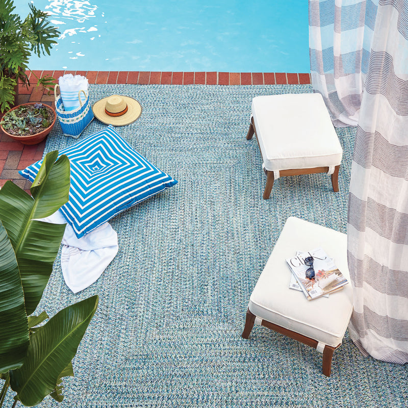 seaside blue outdoor braided rug beside pool