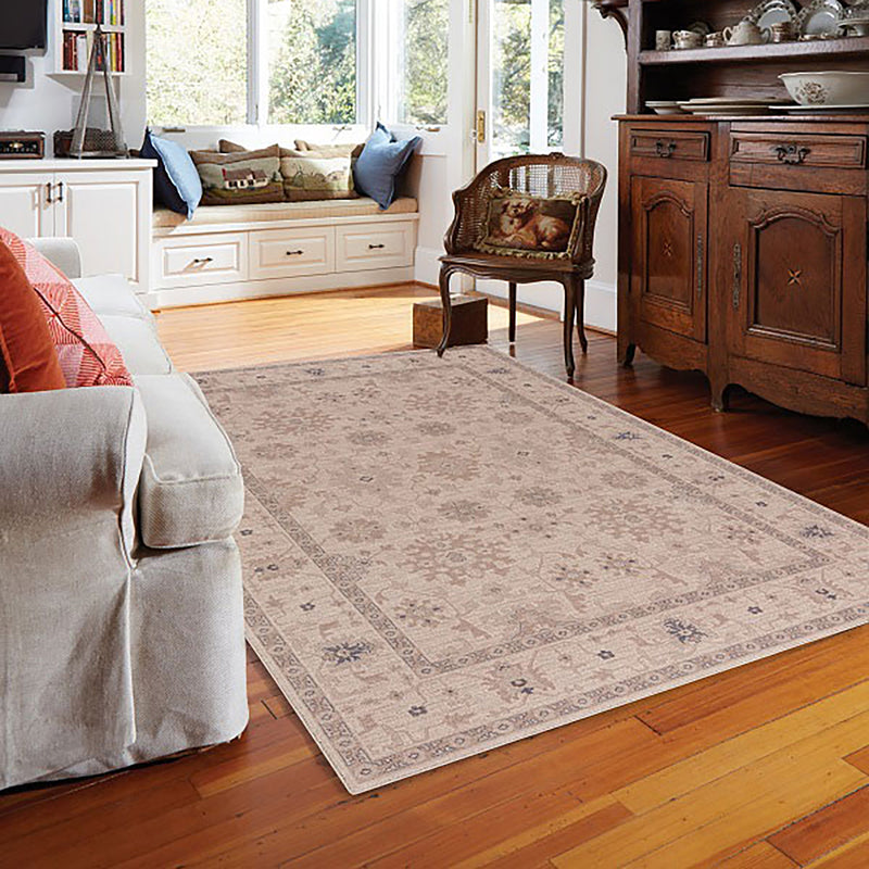 ivory rug on hardwood floor room scene