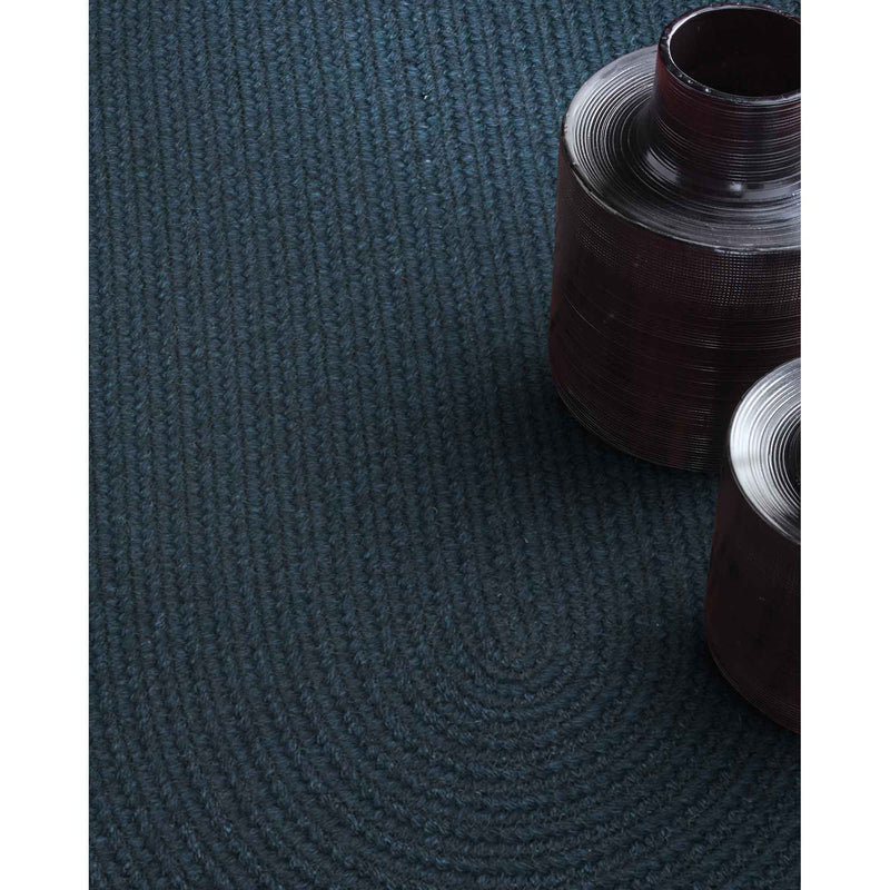 Heathered Pinwheel Navy Blue Solid Braided Rug Oval Roomshot image
