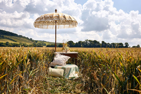 Parasol in wheat field with tablescape