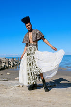 Load image into Gallery viewer, Our Embellished Leather Cape is handmade in Kenya by our local artisan using genuine leather byproduct from local farms, ostrich eggshell, glass Maasai beads and brass beads. All odAOMO garments are designed by Dr. Sophia Omoro and produced in limited quantities.