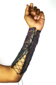 Our Maasai Bead Gauntlets are handcrafted in Kenya by our local artisan using hand-strung glass Maasai beads and genuine leather byproduct sourced from local farms. It is currently available in gunmetal, red or white beading with custom colored beading available. All odAOMO accessories are designed by Dr. Sophia Omoro.
