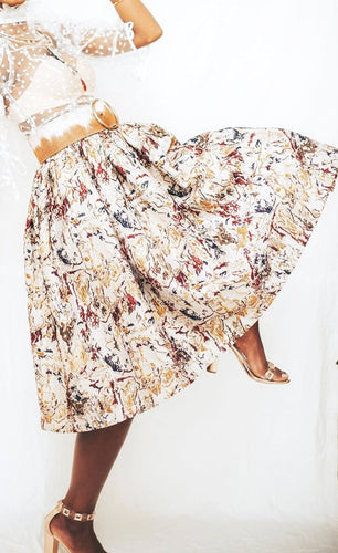 Our Monet Wrap Skirt is handmade in Kenya using a beautifully marbled silk Jacquard sourced from Italy. It features a timeless wrap design and pairs perfectly as a set with or with mix it up with a piece from your own wardrobe. All odAOMO garments are designed by Dr. Sophia Aomo Omoro and produced in limited quantities.