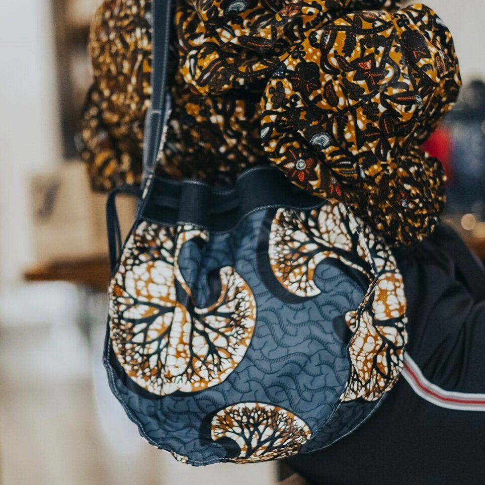 Our Kitenge Drawstring Satchel is the perfect everyday bag. This bag is handcrafted in Nairobi, Kenya by our local artisan using eco-friendly and sustainable materials and all leathers are byproducts from local farms. Each piece is designed by Dr. Sophia Omoro and produced in limited quantities.