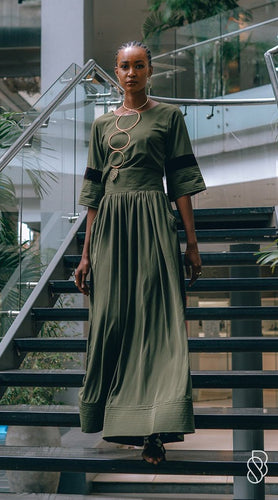 Our Grasslands Silk Crepe Top is handmade in Ghana using eco-friendly and sustainable materials. We've paired it with our Silk Crepe Wide Leg, but it also works great with a pair of jeans, pencil skirt or classic black pant. odAOMO garments are designed by Dr. Sophia Omoro and produced in limited quantities.