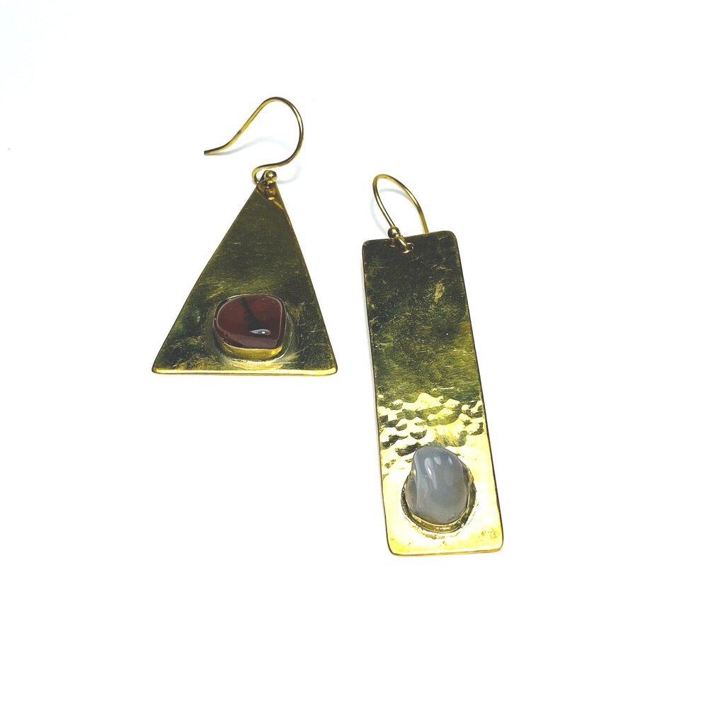 Our Nested Stone Earrings are handcrafted in Nairobi, Kenya by our local artisan using eco-friendly and sustainable materials. These earrings feature a hammered and smooth finish with inset, polished semiprecious stones. All odAOMO jewelry is designed by Dr. Sophia Aomo Omoro and produced in limited quantities.