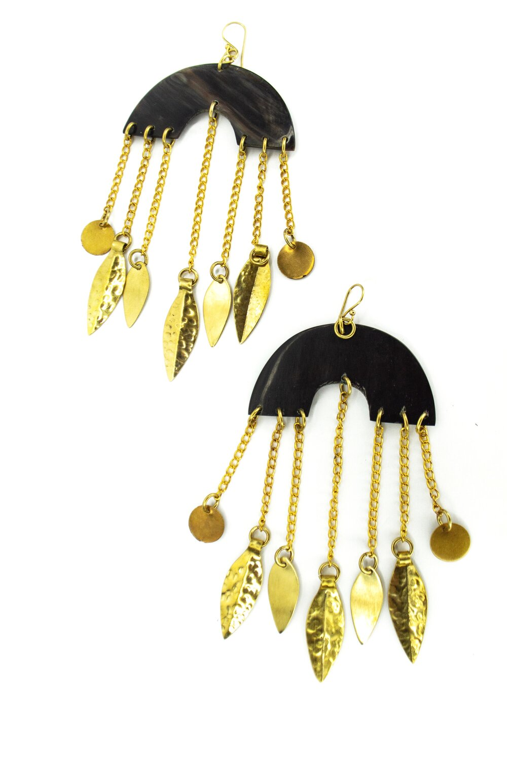 Our Horn Chandelier Earrings are handcrafted in Nairobi, Kenya using recycled solid brass and cow horn byproduct sourced from local farms. These earrings are a a staple for odAOMO and are also available in light horn. All odAOMO jewelry is designed by Dr. Sophia Aomo Omoro and produced in limited quantities.