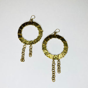 Our Wrapped Chandelier Earrings are handcrafted in Kenya using eco-friendly and sustainable recycled brass. They are available in a circular or rectangular design with wire wrapping and chain detail.  All odAOMO jewelry is designed by Dr. Sophia Omoro and produced in limited quantities.