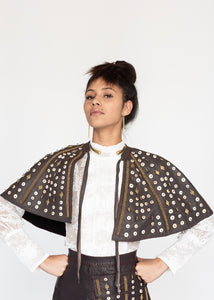 Our Embellished Leather Cape is handmade in Kenya by our local artisan using genuine leather byproduct from local farms, suede lining, ostrich eggshell, glass Maasai beads and brass beads. All odAOMO garments are designed by Dr. Sophia Omoro and produced in limited quantities.