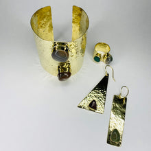 Load image into Gallery viewer, Our Nested Stone Collection is handcrafted in Kenya by our local artisan using 100% recycled brass and inlaid, polished semiprecious stones. The set includes one pair of earrings, one cuff and one ring. All materials used are eco-friendly and sustainable and no two pieces are the same! *Please note these items are handmade, so stone coloration/shapes will vary.