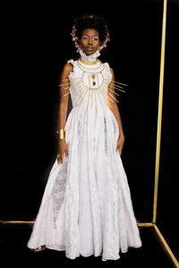 Our High Neck Godet Gown is handmade in Ghana using 100% cotton, sequined embellishment, cotton thread embroidery, and silk blend lace godets. This gown features an Elizabethan high-neck collar with a zippered and button rear closure and silk blend lace godets. All odAOMO garments are designed by Dr. Sophia Omoro.