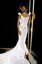 Load image into Gallery viewer, Our Lace Gown is handmade in Ghana using a luxurious silk blend lace. This form fitting and sexy silhouette is guaranteed to compliment any shape. It features a spaghetti strap design, sweetheart neckline, pleated side paneled and an extended train. All odAOMO garments are designed by Dr. Sophia Omoro.