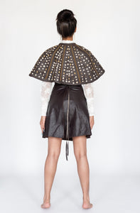 Our Embellished Leather Skirt is handmade in Kenya by our local artisan using genuine leather byproduct from local farms, suede lining, ostrich eggshell, glass Maasai beads and brass beads. All odAOMO garments are designed by Dr. Sophia Omoro and produced in limited quantities.