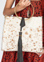 Load image into Gallery viewer, Our Mraba Tote is handcrafted in Nairobi, Kenya using eco-friendly and sustainable materials. This best selling bag features an adjustable leather crossbody strap, brass ring handles and a leather, horn and Maasai bead tassel closure. Each piece is designed by Dr. Sophia Aomo Omoro and produced in limited quantities.