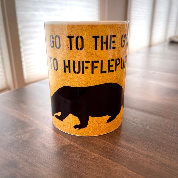 Yellow mug with a black badger and text saying