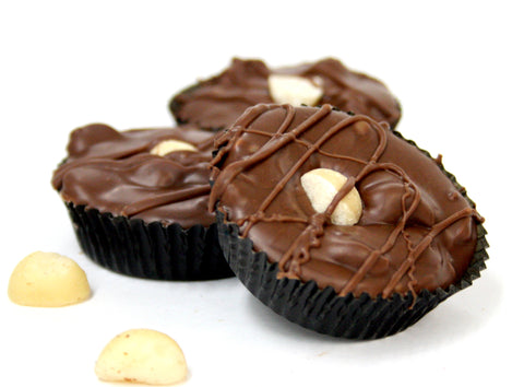 Hand Dipped Milk Chocolate Macadamia Nut Cluster. Net Wt. 1.00 lb.