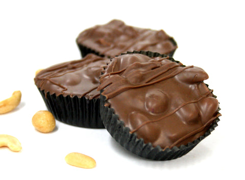 Hand Dipped Milk Chocolate Peanut Cluster. Net Wt. 1.00 lb.