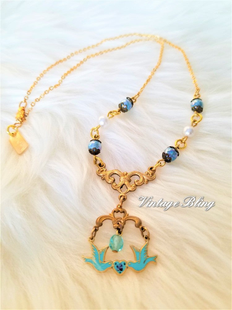 rose products love gold bird necklace