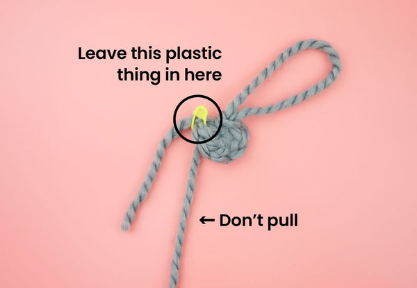 do not touch the plastic thing or pull on the yarn connected to the ball