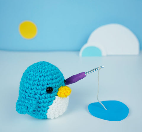 penguin holding crochet hook