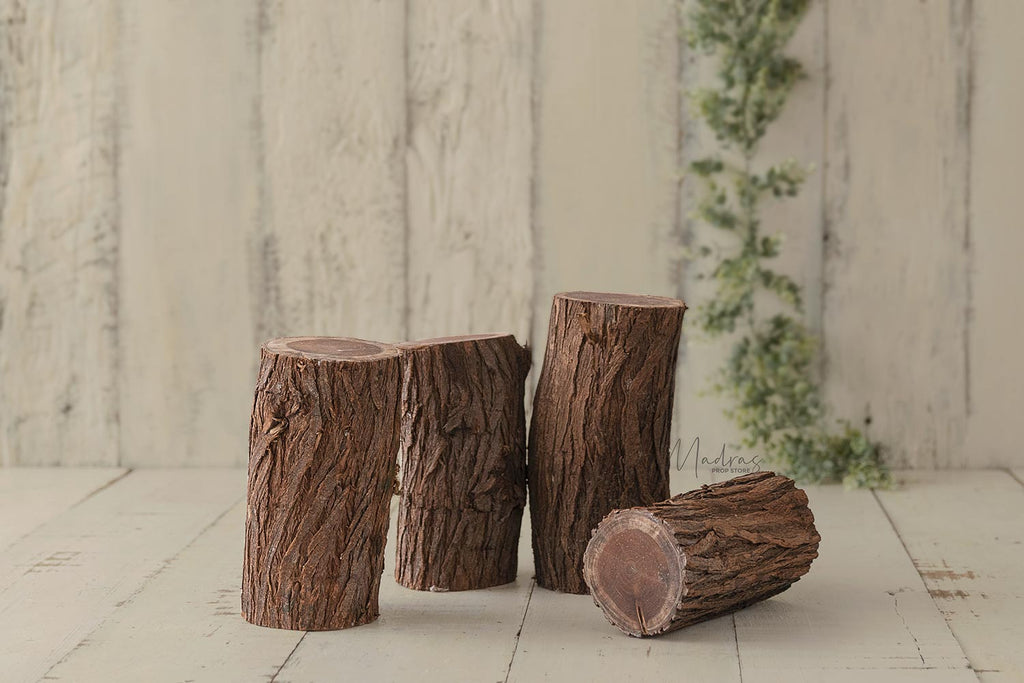 Rentals - Natural wooden barked logs set of 4