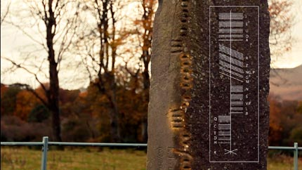 Ogham standing stone with example of Ogham writing
