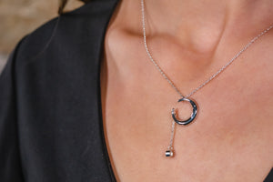Sterling Silver Crescent with CZ attached with a miniature chain.