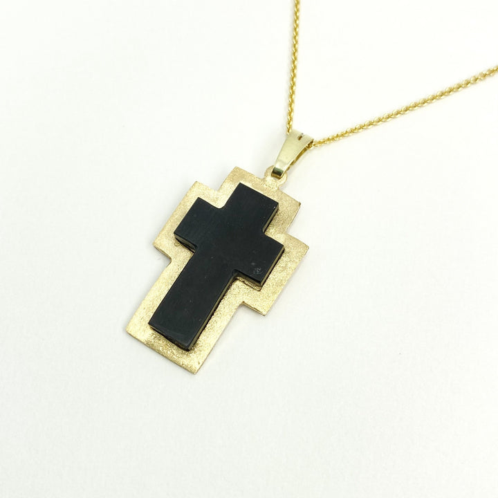 Cross shaped Carraig Dubh stone with 14k Gold