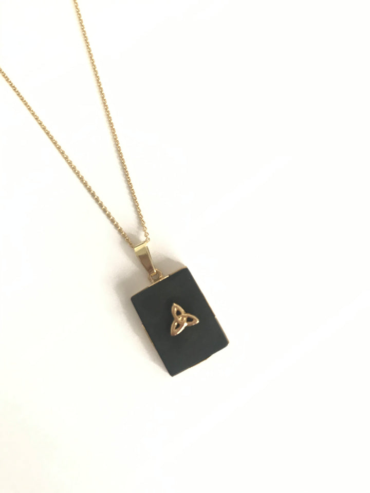 Heritage necklace. Black gemstone surrounded by 14k gold. Gold Trinity Knot with 14k chain