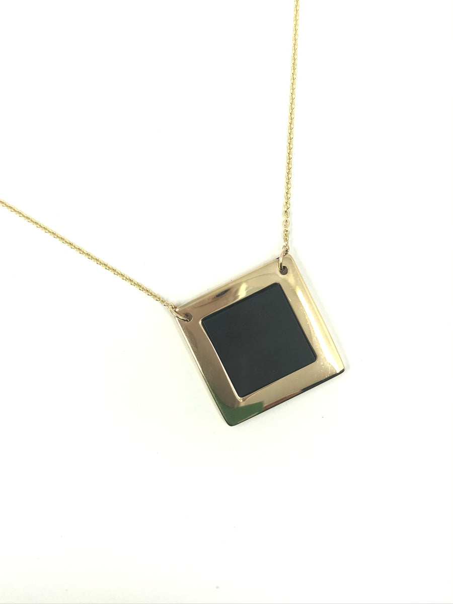 Neart meaning strength. A rectangular Dingle stone surrounded by 14k gold on a 14k chain