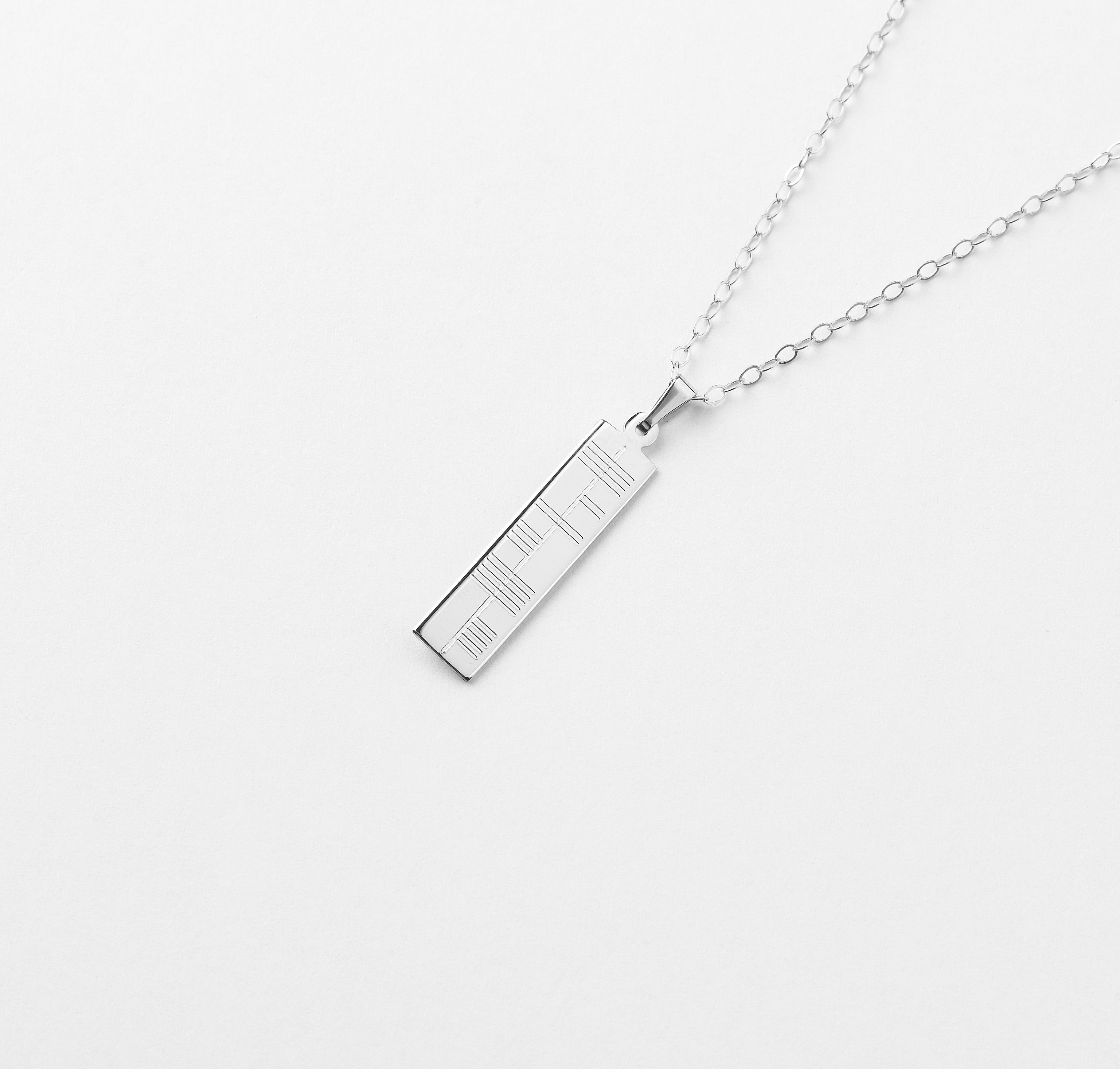 Ogham small pendant by brian de staic with an ogham inscription silver ogham pendant small aloadofball Images