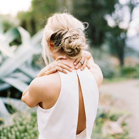 Woman using CBD for pain relief on shoulders